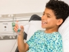 72 Lifestyle Photography Boy Smiling in Hospital Bed