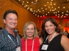 3-People-At-Corporate-Event-In-Texas-With-Lights-Blurred