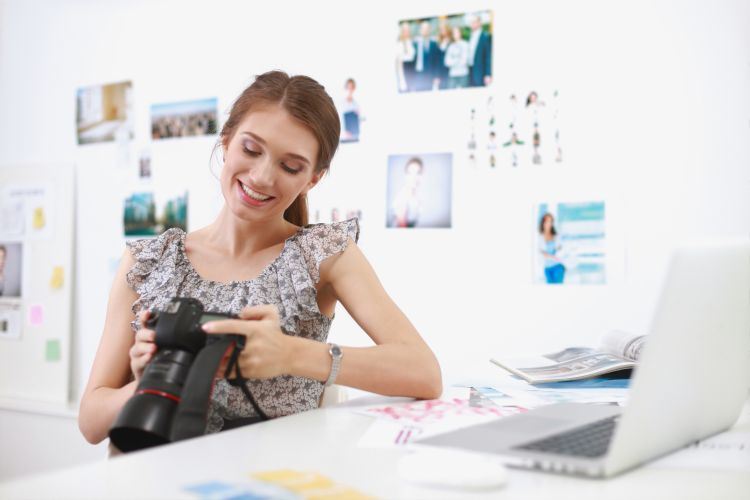 Young woman photographer processing pictures